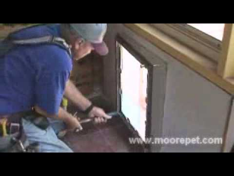 Maxseal pet door wall installation step 8 installing - Interior door with pet door installed ...