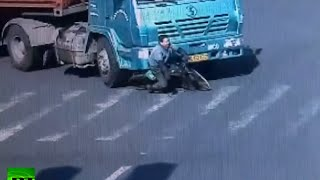 CCTV: Cyclist dodges death when rolled under 14-wheel truck
