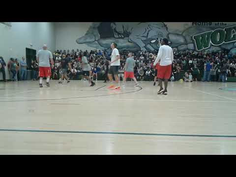 Teachers vs Students in basketball at Gordon Burnett Middle School