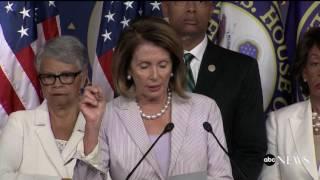 Pelosi standing next to Maxine Waters: