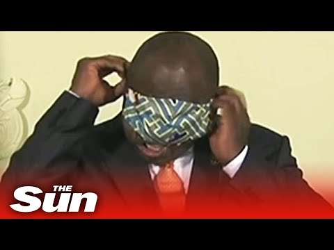 South African president struggles to demo virus mask at coronavirus briefing