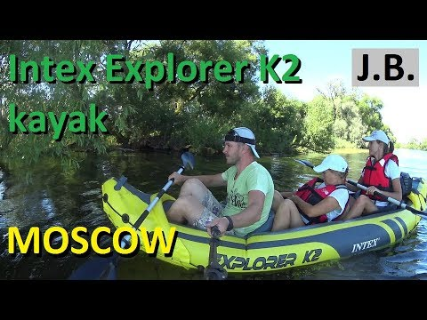 Three Persons Kayaking On Intex Explorer K2. Moscow Region