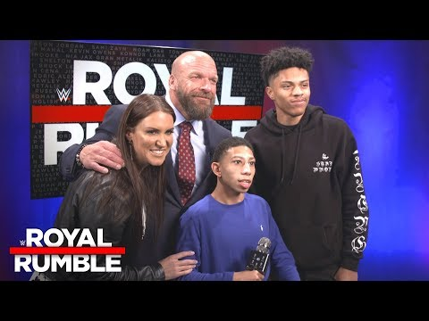 Stephanie McMahon & Triple H give a hero's welcome to two deserving : Exclusive, Jan. 28, 2018