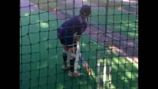 Back lift hooking around just before ball is bowled.