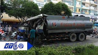 Xe bồn cày nát dải phân cách, tông xe buýt | VTC