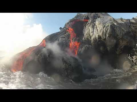 Close up video of Lava entering the ocean shot with Gopro