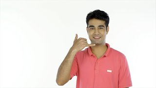 Smiling young guy doing phone gesture while looking at the camera - lifestyle concept