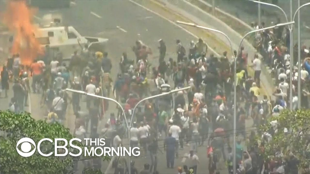 Venezuelan opposition leader calls for continued protests as military vehicles charge crowds