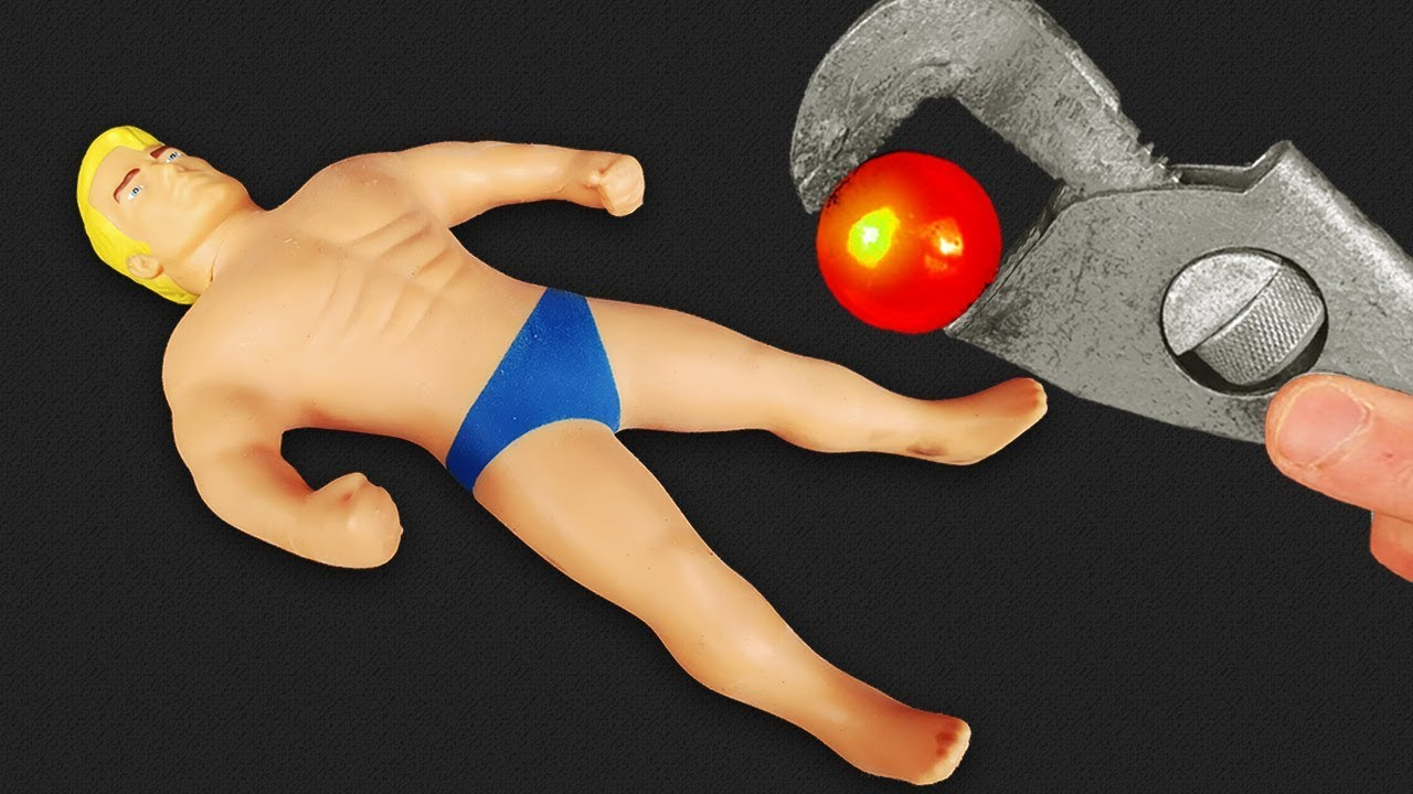 experiment-glowing-1000-degree-metal-ball-vs-stretch-armstrong