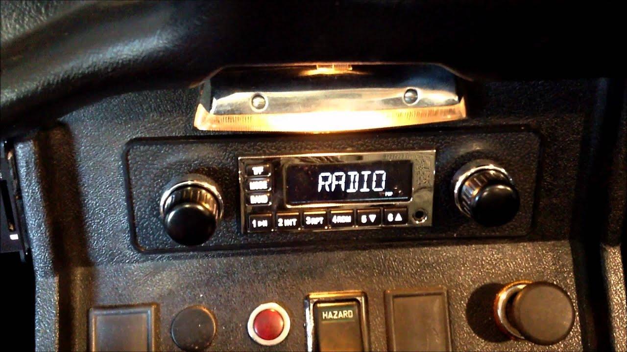 1974 mgb with a retro sound model 1 massive nx2 and jl audio c2650x [ 1280 x 720 Pixel ]