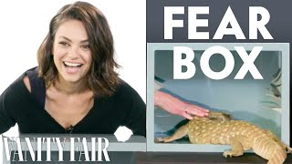 "On the latest episode of ""Fear Box,"" Mila Kunis, Kristen Bell, and Kathryn Hahn take on the scary challenge of sticking their hands in a box and touching surprise ..."