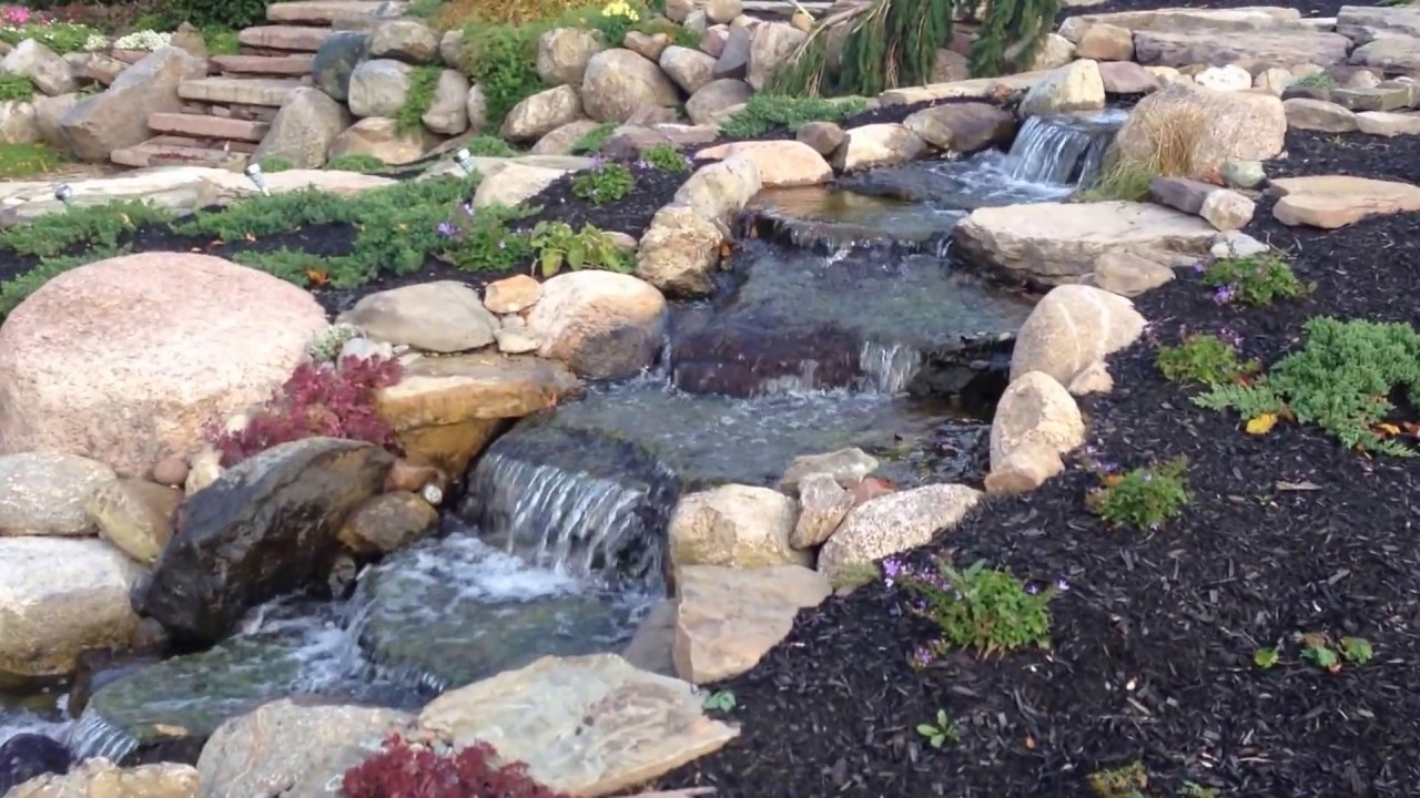 beautiful waterfall pond natural stone patio monroe county