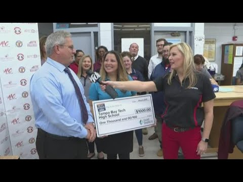 Duke Energy Florida presents check to Tampa Bay Technical High School