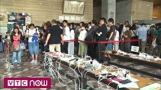 Lại động đất, người Nhật xếp hàng dài chờ sạc điện thoại