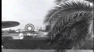 Pan American Airways operating Lockheed Electra L-10 passenger plane at Havana ai...HD Stock Footage