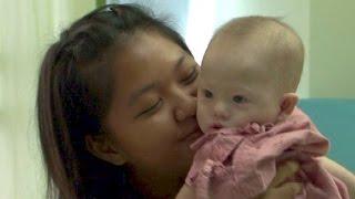 Leihmutter liebt behinderten Gammy wie eigenes Baby