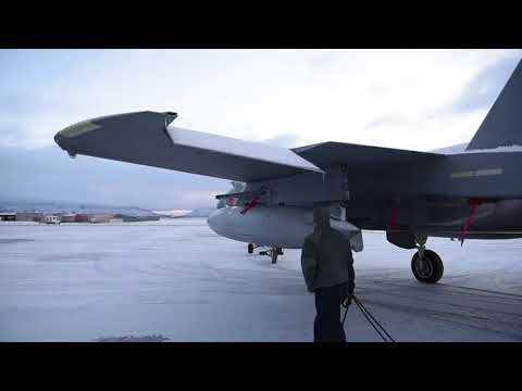 Ground crews tow F-15 Eagles out of the way Kingsley Field snow removal crews, Kingsley Field