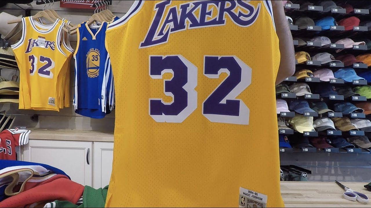 f0790042cdc Magic Johnson Mitchell & Ness Throwback Swingman Jersey - YouTube