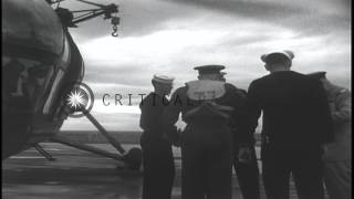 Dwight Eisenhower with others arrive in a H-5 helicopter on USS Franklin D. Roose...HD Stock Footage