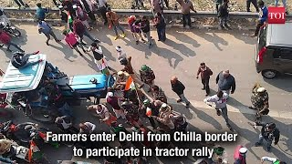 Tractor rally: Farmers enter Delhi from Chilla border, break police barricade