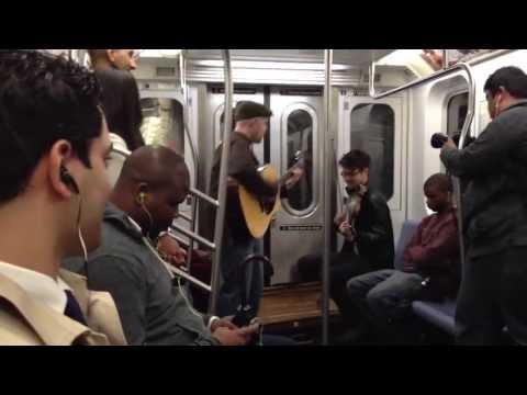 Random subway jam session turns into proposal!