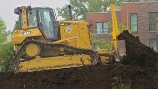 caterpillar dozer d6n pushing topsoil grading surface