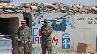 US troops wait 30 km north of Erbil, Iraq to enter the city