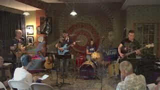 Nic Performing Susie Q Main Street Music and Art Studio