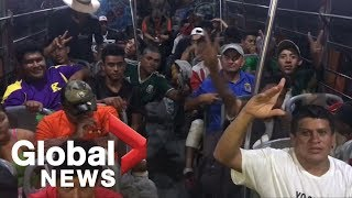 migrant-caravan-begins-final-trek-towards-tijuana-on-buses