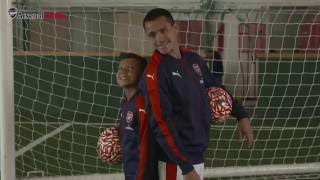 They're behind you! Alexis and Xhaka surprise Junior Gunners
