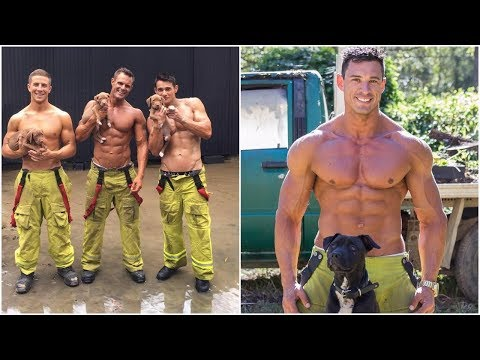 Firefighters posing to Rescue Puppies ,all rescued dogs are up for adoption