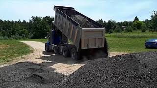 How to fix muddy driveway with recycled asphalt.