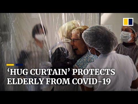 'Hug curtain' allows elderly safe cuddles from Covid-19 isolation at Brazil nursing home