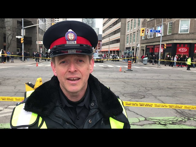 Sgt. Brett Moore from Toronto police traffic services at the scene where a woman in her 60s died after she was fatally struck by a TTC bus near Bloor St. E. and Sherbourne St.  Friday morning.  Credit: Steve Russell/Toronto Star