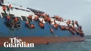 Passengers cling to side of stricken ferry in Indonesia