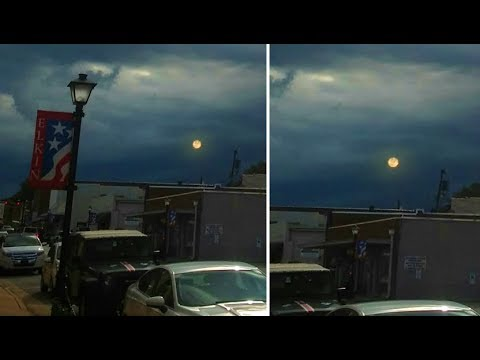 This Couple Photographs What Appears To Be A Second Moon