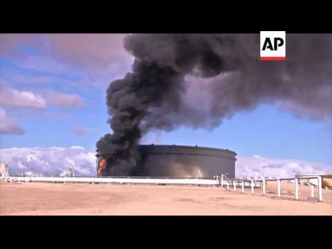 Storage tank hit as armed groups fight for control of biggest oil export terminal