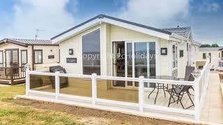 8 berth dog friendly Lodge with a full seaview at Hopton Haven call us 01362 470888