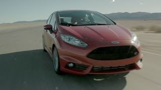 2014 Ford Fiesta ST Review - TEST/DRIVE(Mike Musto reviews the 2014 Ford Fiesta ST at Chuckwalla Valley Raceway in California. Scored by all TEST/DRIVE hosts., 2014-01-27T15:00:07.000Z)