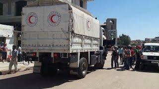 أول قافلة مساعدات منذ يونيو تدخل حيا محاصرا في حمص السورية