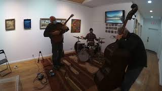 Brian Kastan acoustic guitar, Mike Bisio upright bass, Peter O'Brien drums
