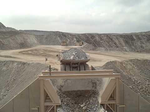 Haul truck dumping into feeder of gyratory crusher