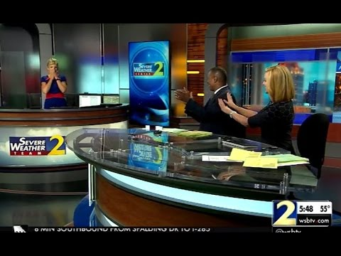 Meteorologist drawn to tears after tribute video - YouTube