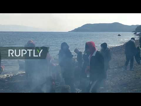 LIVE: Refugees come ashore on Lesbos as Turkey opens its borders