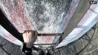 Going Down A Ladder Off The Side Of A 900-Foot Tower Is Scarier Than Climbing Up