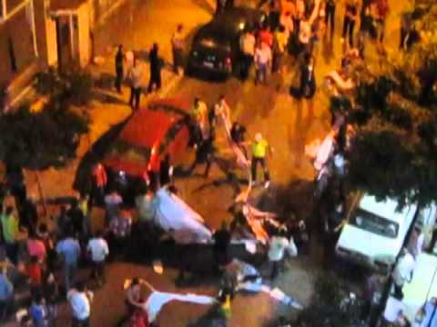 Pro Hamdeen Sabahi protesters tear up Morsi posters in Cleopatra Hamamat, Alexandria