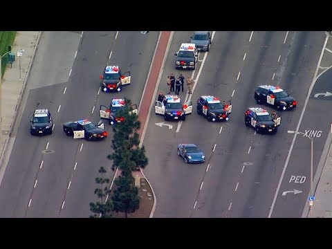 Chase ends in crash, standoff on busy Santa Ana street