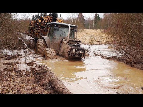 Valtra forestry tractor logging in wet conditions