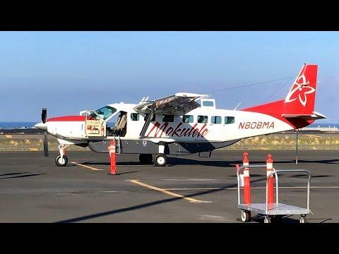 MOKULELE AIRLINE Cessna 208B and pilots await air tour passengers on Kailua Kona- Kahului route