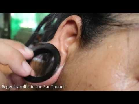 How To Put Large Tunnel Earings To Ear Tunnel Hole Youtube